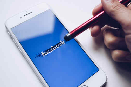Facebook frustrates a user on smartphone